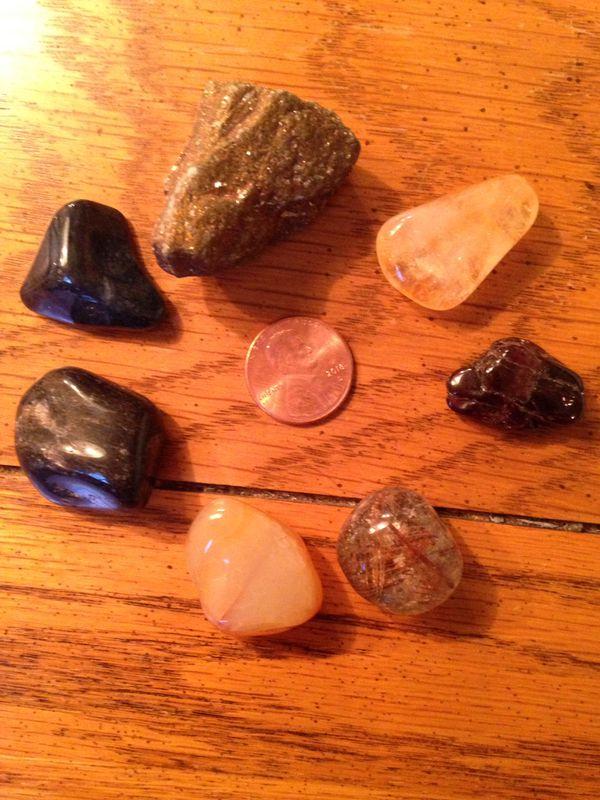 Crystals (citrine, garnet, rutilated quartz, orange agate, blue aventurine, dumorterorite and peacock ore.