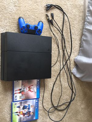 PS4 with blue controller and black control almost never used with 2 games all here for Sale in Vienna, VA
