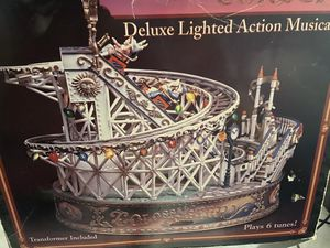 Authentic Enesco Deluxe Lighted action musical rollercoaster for Sale in Lakeland, FL
