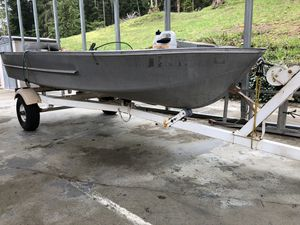 Hews Craft 12 1/2' 3 bench aluminum boat. Excellent custom trailer. 8 hp Mercury outboard and 5 hp 5 spd Mincota trolling motor. Too much to list. for Sale in Buckley, WA