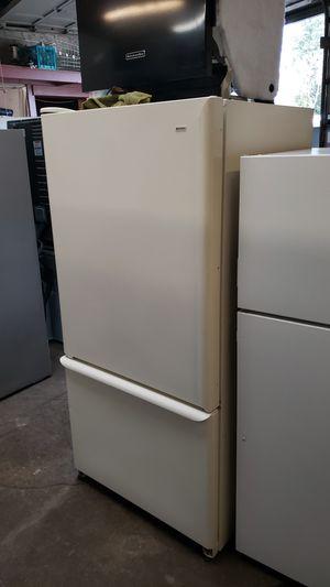 Kenmore Refrigerator with Ice maker bottom freezer Adjustable glass shelves Bisque for Sale in Portland, OR