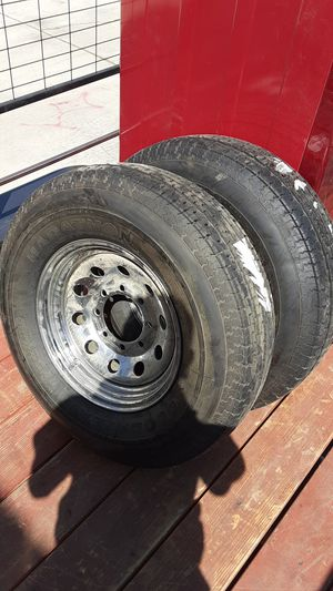 2 New trailer tires and wheels st235 80 r16 for Sale in Victorville, CA