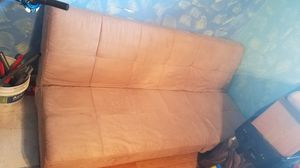 Futon bed,tan in color with two pillows,folds upwards and folds on 1 end for Sale in West Palm Beach, FL