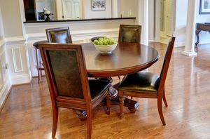 "High quality table with extra leaf; leather chairs 60"" for Sale in Atlanta, GA"