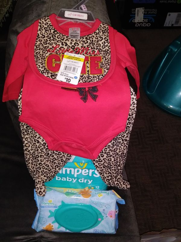 Diapers wipes and baby outfit