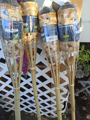 Tiki torches the seal brand new never been opened for Sale in Visalia, CA