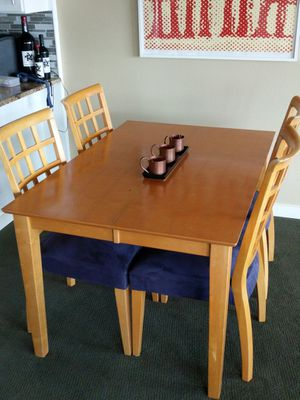 Dining table with hiding/fold-under leaf and 4 chairs. for Sale in Denver, CO