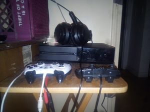 X box 1 7 games 2 controls and headphones for Sale in Boston, MA