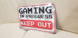 "Gaming in progress keep out embossed metal funny kid's or gamer room door sign brand new measures 12"" x 7"" has 1 hole at top for easy hanging for Sale in Ontario, CA"