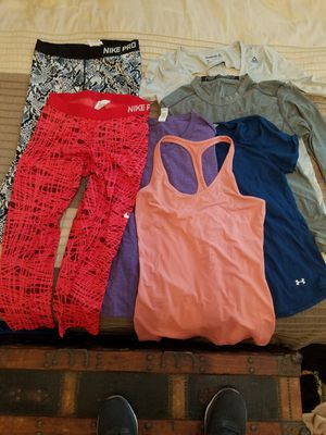 Nike, Underarmour and Reebok. Women's athletic wear all size large! 2 pants, 2 long sleeve tops, 2 short sleeve tops and 1 racer back tank!!! for Sale in Portland, OR