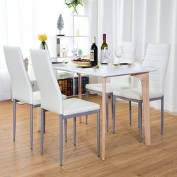 4 pcs PVC Leather Elegant Design Dining Side Chairs - White for Sale in Ontario,  CA