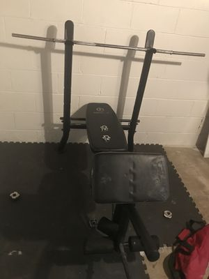 BENCH WITH WEIGHTS AND BOXING BAG for Sale in Dearborn, MI