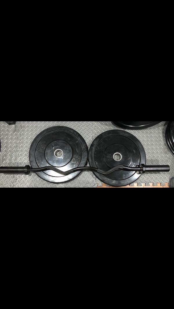 Pair of 25lbs Bumper/ Rubber Olympic Plates/ Weights, Olympic curling Barbell, and pair of collars.