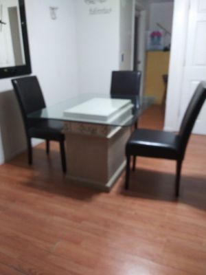 Dinning Table has 4 chairs we painted ourselves.... And we put boarder on... Asking 75... for Sale in New Port Richey, FL