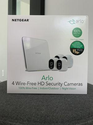 4 wire free Arlo cameras + base for Sale in Miami, FL