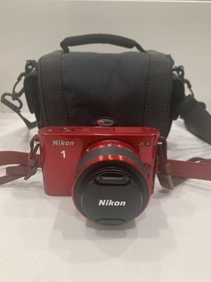 Red Nikon 1 camera with zoom in lens and bag for Sale in Corona, CA