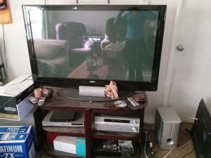 55 inch sanyo tv with stand and surround sound for Sale in Prescott, OR