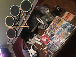Nintendo Wii with all cords, 4 controllers, rechargeable stand, wii stand, 10games, drum set, guitar, microphone, tony hawk with skateboard for Sale in Philadelphia, PA