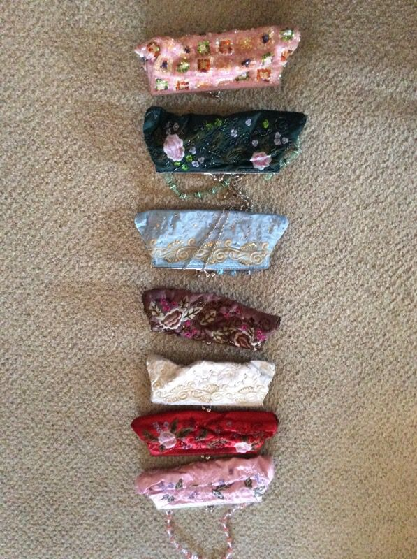 Hand made embroidered clutches