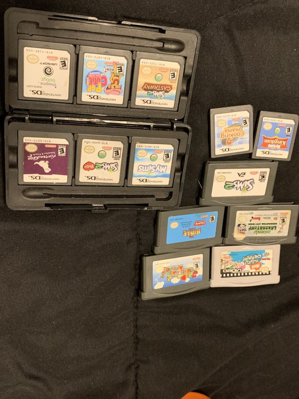 Nintendo DS Lite w/ Games , charger , and game holder