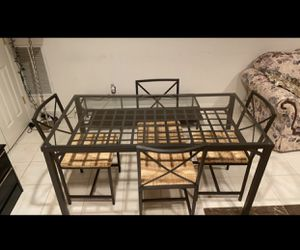 Table + 4 chairs for Sale in Pikesville, MD
