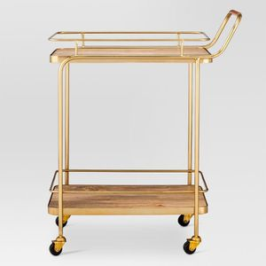 Metal, Wood, and Leather Bar Cart - Gold - Threshold™ Attractive gold metal frame Wood shelves for sturdy storage Convenient casters allow for easy for Sale in Sierra Madre, CA
