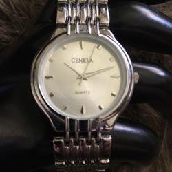 Men's Geneva silver tone weave link watch for Sale in Henderson,  NV
