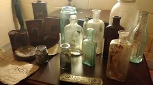 Old mason jars medical bottles t tin cans and old Harmonica made in Germany for Sale in East Dublin, GA