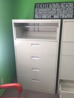 We have 2 tall 5 Draw Metal file cabinets for Sale in St. Louis, MO
