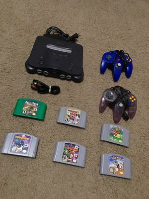 Nintendo 64 come with 2 controllers and 6 games for Sale in Raleigh, NC