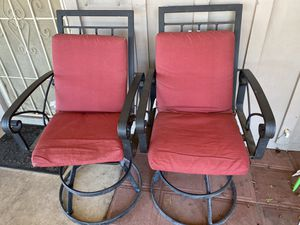 2 patio chair swivel with cushions red black for Sale in Phoenix, AZ