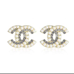 Oversized cc pearl and crystal stud earrings for Sale in Clearwater, FL
