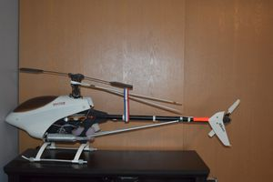 Raptor 30 class RC helicopter with lots of extra parts for Sale in Roy, WA