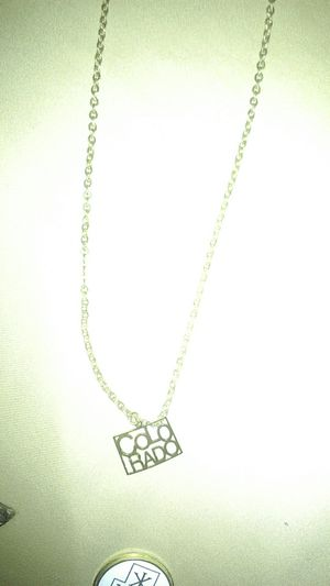12k gold.circle chain and Colorado charm for Sale in Denver, CO