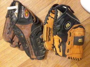 Black and brown leather baseball gloves for Sale in Murray, UT