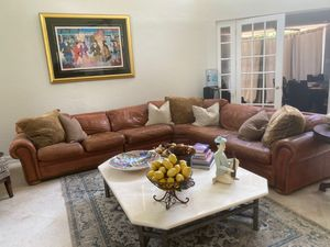 Leather sectional with nailheads on arms of couch for Sale in Boca Raton, FL