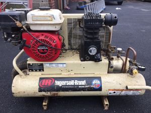 Compressor ( wheelbarrow) plus two nailing gun and hose for Sale in Newark, NJ