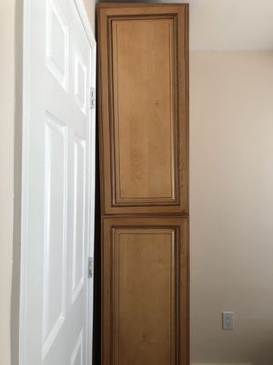 Wooden cabinet, tall, intricate detail. Never used, shelves included. Width front to back 24inchs. Width across front 17.5inches. Height 92.5inches for Sale in Elkridge, MD