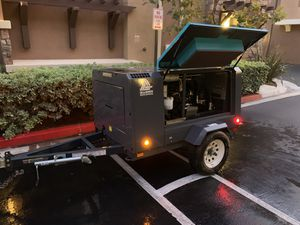 Tow behind compressor with custom cover first aid kit fire extinguisher and gps tracker for Sale in San Diego, CA