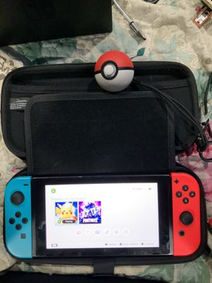 Nintendo switch Pokémon go edition with poke ball control 64 go sd card and games for Sale in San Jose, CA