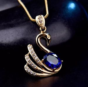 18kt Yellow Gold Filled Blue Sapphire Swan Pendant Necklace for Sale in Silver Spring, MD