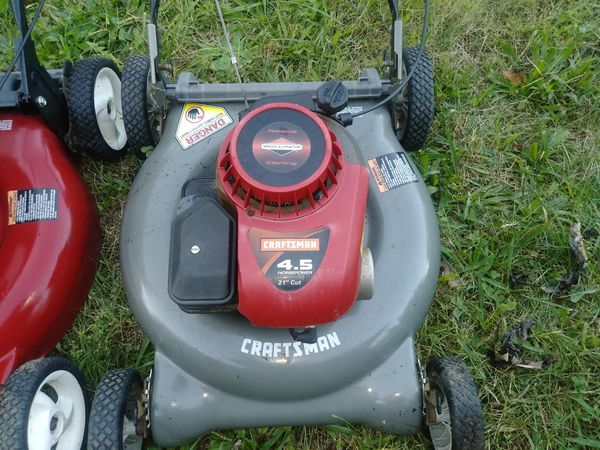 3 lawn mowers and a weed eater
