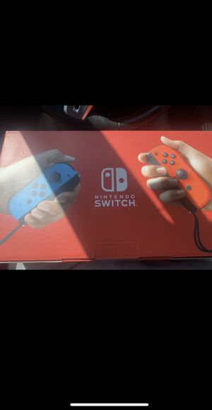 NEW Nintendo Switch with Neon Blue and Neon Red Joy‑Con Handheld Gaming Console for Sale in Hurst, TX