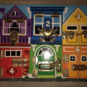 Melissa & Doug Latch Toy Board for Sale in Riverside, CA