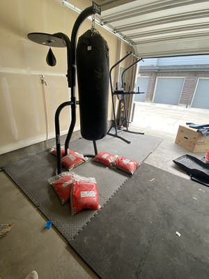 100 LB Champion heavy bag, Everlast stand, Everlast speed bag, Elite Fitness pull up/dip/ab rack, and (6) 50 LB sand bags. for Sale in Centennial, CO