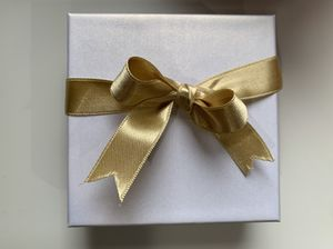 New white Souvenir Box with Gold Color Ribbon for Sale in Quincy, MA