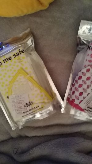 Keep me safe. Two different masks with cases. Adult size reusable face mask with case. $10 for both. New. for Sale in PA, US