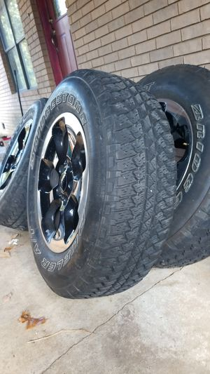 Black jeep rims and matching tires for Sale in Van Buren, AR