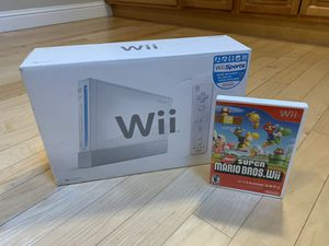 Nintendo Wii console w/ New Super Mario Bros., Wii Sports, and Donkey Kong Country Returns for Sale in San Jose, CA
