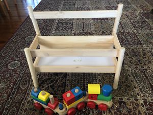 Wooden bookshelf and train for Sale in Bartow, FL